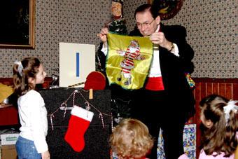Audience Volunteer Helping with Santa's Suit